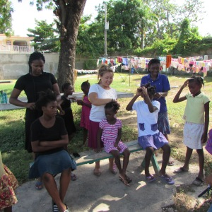 Braiding the girls' hair, at the girls' home